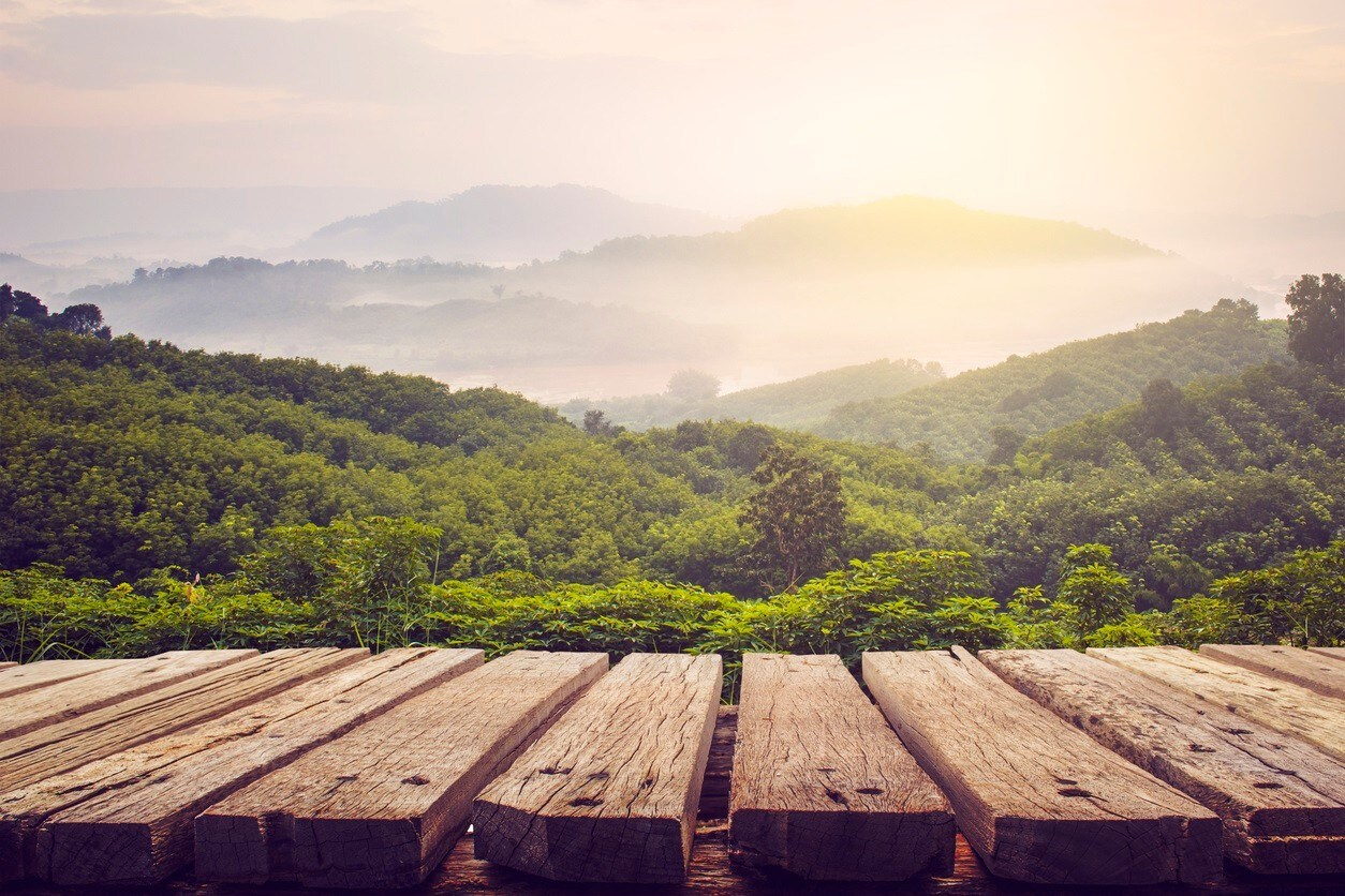 wooden table and view of mountain with sun light,vintage process picture